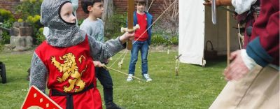Boy dressed as knight at a Commandery event.