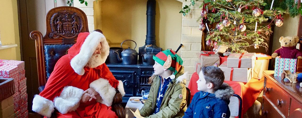 Santa with two boys in elf ears