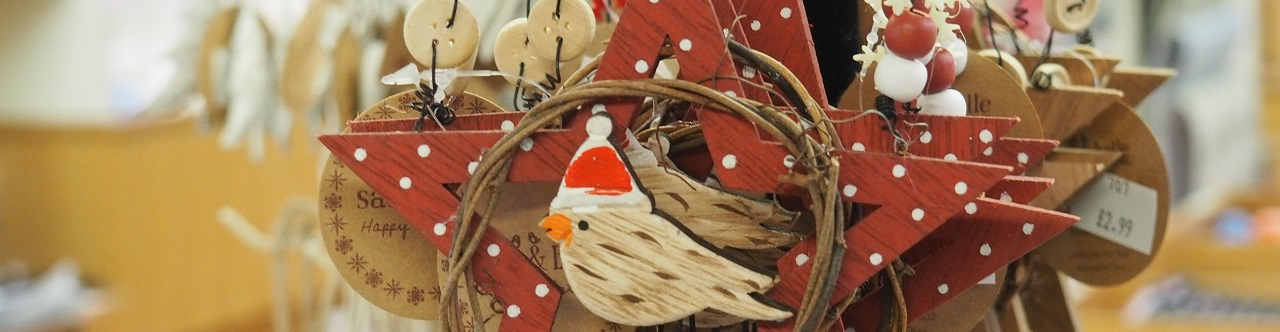Pretty Christmas decorations hanging in The Commandery shop.