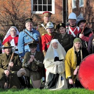 A press shot of living history reenactors in The Commandery gardens.